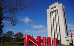 The NIU Huskie Pride Statue and Holmes Student Center are recognizable landmarks to help new students find their way around campus.