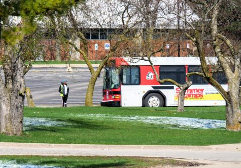 NIU Bus driver looks around an empty campus before continuing their route.