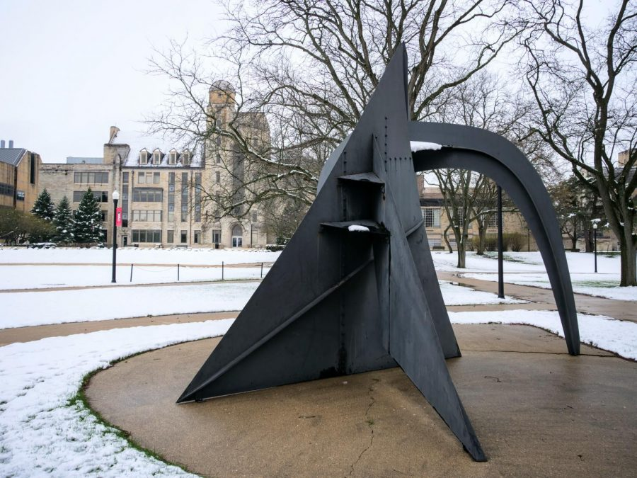 Snow on the Central Quad sculpture begins to melt away.