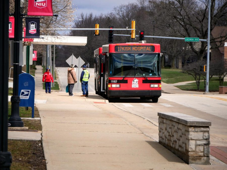 NIU bus driver speaks with a passenger Monday outside the Holmes Student Center.