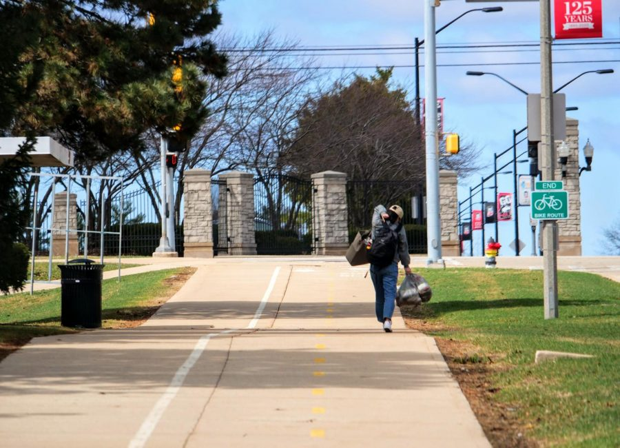 An NIU student walks down Lucinda Avenue Monday with groceries.