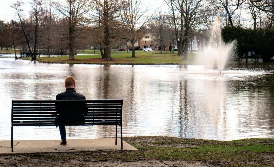 Parker Meadows, senior political science major, reads a book Monday beside the lagoon.