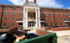 A dumpster sits outside Gilbert Hall Monday filled with trash from students moving out early because of the COVID-19 pandemic.