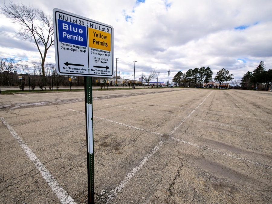 The parking lot behind Gabel Hall sits empty Monday. During a typical semester, Lot 38 is usually full, but due to the NIU's campus shutting down, most of the parking lots are barren.