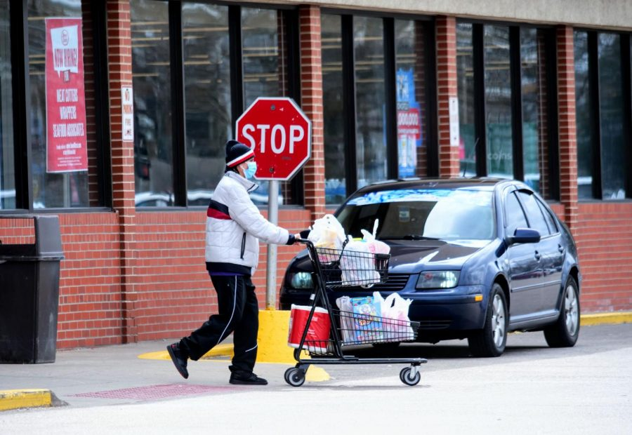 A customer leaves their local grocery store Monday during the COVID-19 pandemic.