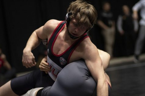 Redshirt sophomore Brit Wilson grapples with his opponent March 7 during his Semifinal match at the 2020 MAC Wrestling Championships at the NIU Convocation Center.