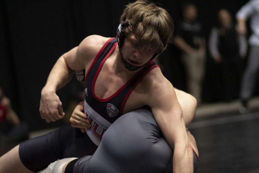 Then-redshirt+sophomore+Brit+Wilson+grapples+with+his+opponent+March+7%2C+2021+during+his+Semifinal+match+at+the+2020+MAC+Wrestling+Championships+at+the+NIU+Convocation+Center.