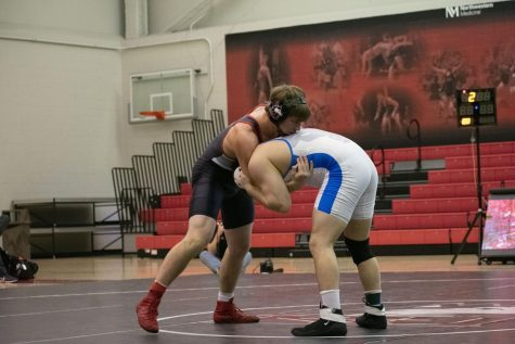 Then-redshirt sophomore Brit Wilson grapples Feb. 14 with his Bull opponent during NIU