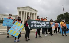 Deferred Action for Childhood Arrivals students stand Thursday in front of the Supreme Court after the Supreme Court ruled to block actions to end DACA.