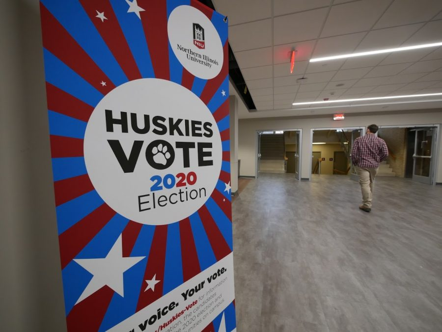 A+Huskies+Vote+sign+stands+in+the+Holmes+Student+Center.+