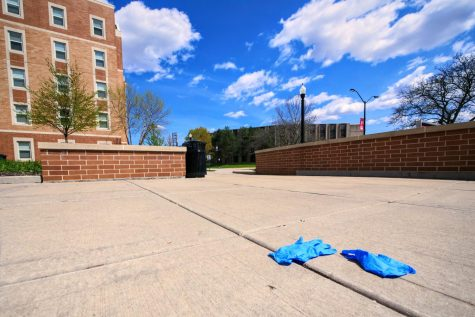 Littered plastic gloves lay on the ground outside the New Residence Hall Community Center in DeKalb on Wednesday, May 6th.