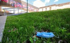 Disposable face mask lays in the grass outside NIU's Founder's Memorial Library on Tuesday, May 12th.