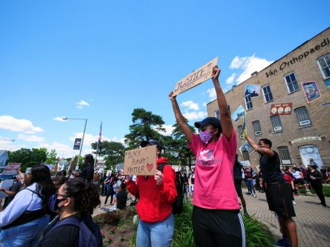 Protesters hold up signs Saturday to passing cars during a protest for Black Lives Matter, in response to the death of George Floyd.
