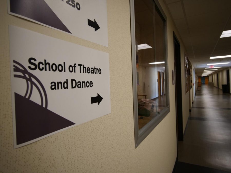 a sign points to the School of Theatre and Dance