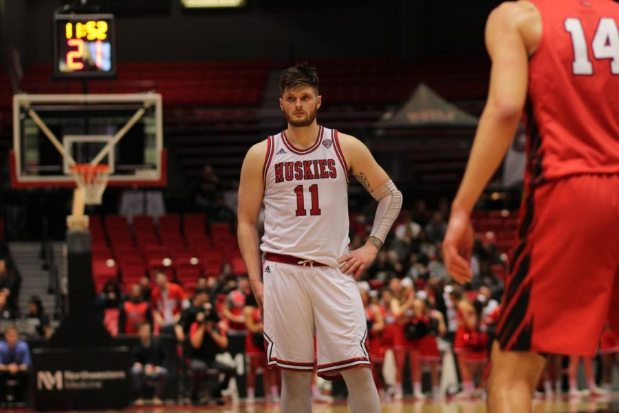 Senior+forward+Noah+McCarty+wait+for+play+to+resume+March+6%2C+during+NIU%27s+loss+to+Ball+State+University+at+the+Convocation+Center.
