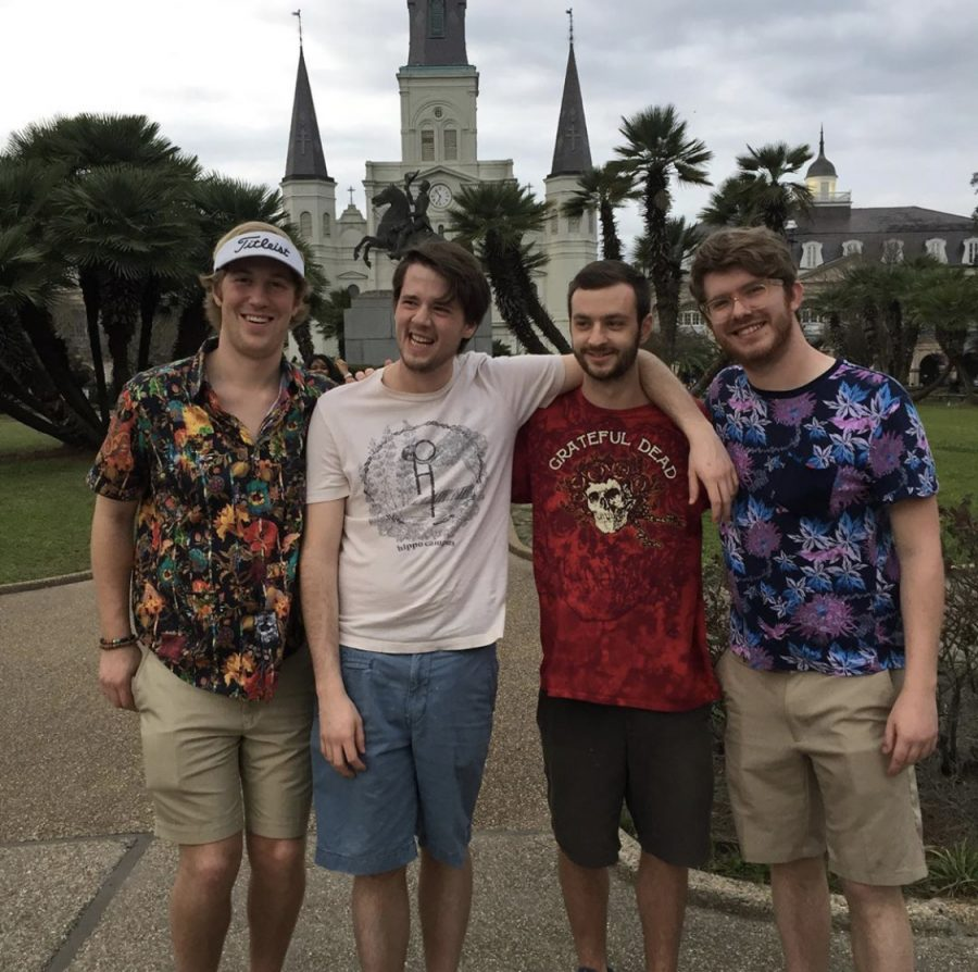 Four+friends+pose+in+front+of+New+Orleans+building
