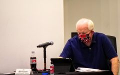DeKalb City Council member, Bill Finucane reviews the agenda for the meeting on July 27th.