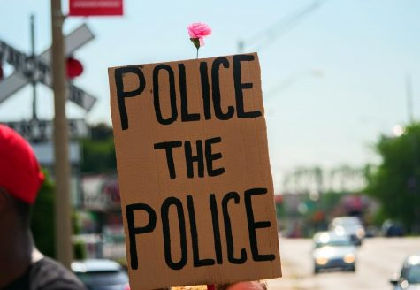 A Black Lives Matter protester holds up a sign in front of The DeKalb Police Department in support of police reform and Black Lives Matter on June 3rd.