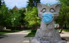 A mask is taped to NIU's Olive Goyle statue next to Altgeld Hall June 3..