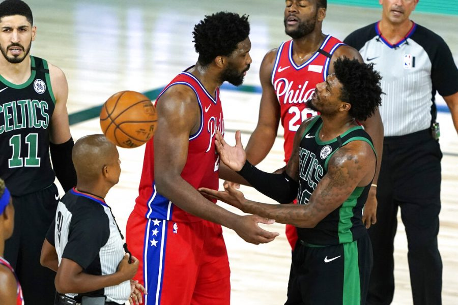 Philadelphia 76ers Joel Embiid, left, and Boston Celtics Marcus Smart, right, exchange words during the second half of an NBA basketball first round playoff game Monday, Aug. 17, 2020, in Lake Buena Vista, Fla.