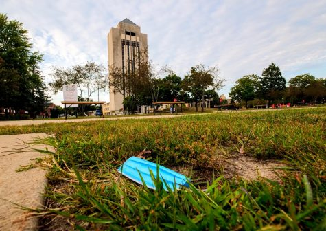 A littered mask lies in the dirt near MLK Commons on August 22nd.
