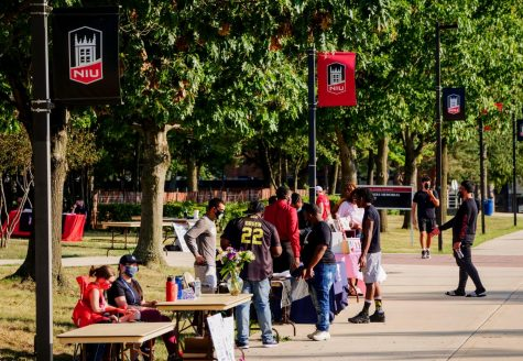 Student organizations wear masks during the involvement fair Sunday in MLK Commons.