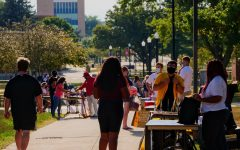 Student organizations wait at tables to get students involved with them at NIU's involvement fair in August 2020.