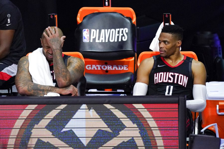 Houston Rockets P.J. Tucker, left, and Russell Westbrook sit on the bench in the closing minutes of a loss to the Los Angeles Lakers during the second half of an NBA conference semifinal playoff basketball game Saturday, Sept. 12, 2020, in Lake Buena Vista, Fla.