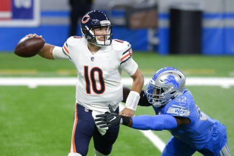 Chicago Bears quarterback Mitchell Trubisky (10) throws under pressure from Detroit Lions outside linebacker Christian Jones (52) in the first half of an NFL football game against the in Detroit, Sunday, Sept. 13, 2020.