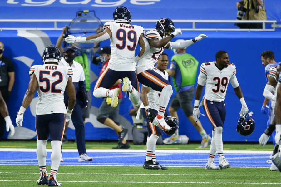 Chicago Bears' Trevis Gipson (99) and Sherrick McManis (27) celebrate their 27-23 win against the Detroit Lions after an NFL football game in Detroit, Sunday, Sept. 13, 2020.
