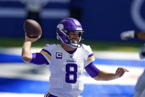 Minnesota Vikings quarterback Kirk Cousins (8) throws during the first half of an NFL football game against the Indianapolis Colts, Sunday, Sept. 20, 2020, in Indianapolis.