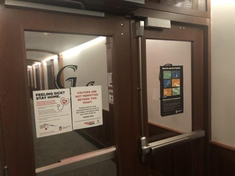 A door in Gilbert Residence Hall shows a sign stating No Visitors Allowed