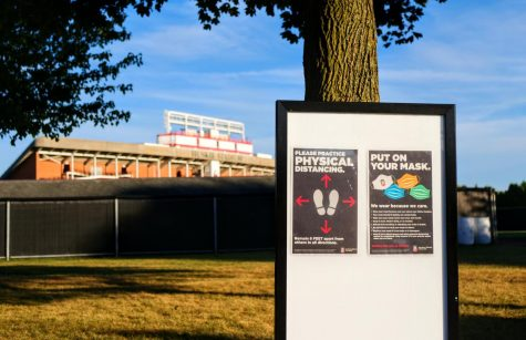 A COVID-19 awareness sign Sept. 2, posted in view of Huskie Stadium in DeKalb.