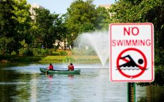 Students canoe across the lagoon on Labor Day.