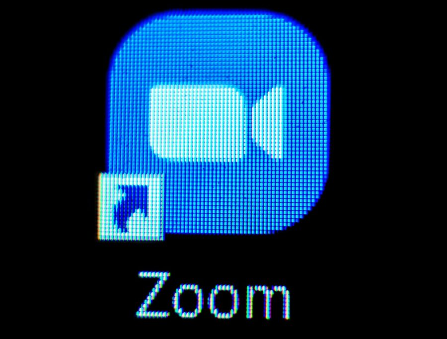 A computer desktop lists the shortcut to Zoom
