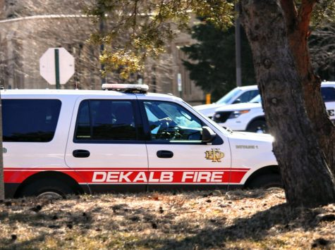 DeKalb Fire Department vehicle drives down Lucinda Ave.