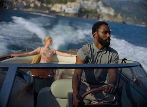 "This image released by Warner Bros. Entertainment shows Elizabeth Debicki, left, and John David Washington in a scene from ""Tenet.""  (Melinda Sue Gordon/Warner Bros. Entertainment via AP)"