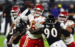 Kansas City Chiefs quarterback Patrick Mahomes (15) throws under pressure by Baltimore Ravens outside linebacker Pernell McPhee (90) during the first half of an NFL football game Monday, Sept. 28, 2020, in Baltimore.