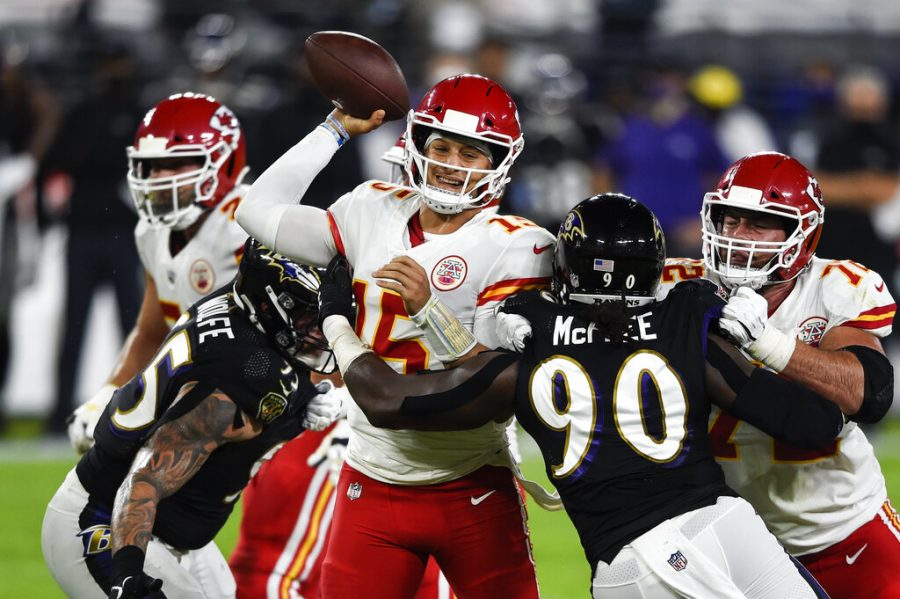Kansas+City+Chiefs+quarterback+Patrick+Mahomes+%2815%29+throws+under+pressure+by+Baltimore+Ravens+outside+linebacker+Pernell+McPhee+%2890%29+during+the+first+half+of+an+NFL+football+game+Monday%2C+Sept.+28%2C+2020%2C+in+Baltimore.