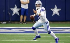 Dallas Cowboys quarterback Dak Prescott (4) scrambles out of the pocket before throwing a pass in the second half of an NFL football game against the Cleveland Browns in Arlington, Texas, Sunday, Oct. 4, 2020. (AP Photo/Ron Jenkins)