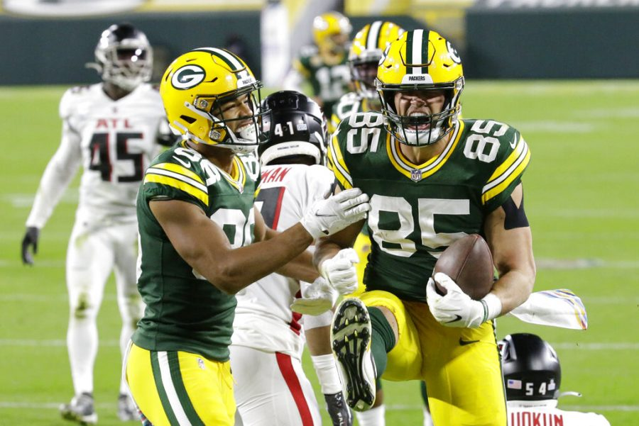 Green Bay Packers' Robert Tonyan (right) celebrates a touchdown reception with Malik Taylor (left) during the first half of an NFL football game against the Atlanta Falcons, in Green Bay, Wisconsin.