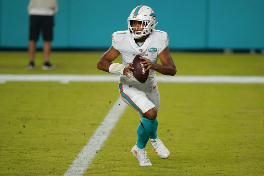 Miami+Dolphins+quarterback+Tua+Tagovailoa+%281%29+looks+to+pass+the+ball+during+the+second+half+of+an+NFL+football+game+against+the+New+York+Jets%2C+Sunday%2C+Oct.+18%2C+2020%2C+in+Miami+Gardens%2C+Fla.+Hopes+are+high+Tagovailoa+will+be+the+best+of+the+22+quarterbacks+to+start+for+Miami+since+Dan+Marino+retired+following+the+1999+season.