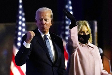 Democratic presidential candidate former Vice President Joe Biden arrives to speak to supporters, early Wednesday, Nov. 4, 2020, in Wilmington, Del., as Jill Biden looks on. (AP Photo/Paul Sancya)