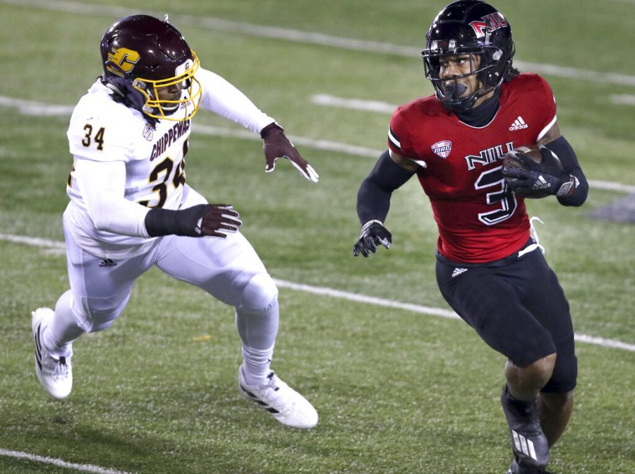 Northern Illinois receiver Tyrice Richie gets past Central Michigan defensive lineman Amir Siddiq during an NCAA college football game Wednesday, Nov. 11, 2020, in DeKalb, Ill.