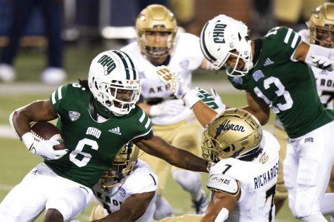 FILE — In this Nov. 10, 2020 file photo, Ohio Bobcats wide receiver Isiah Cox (6) runs the ball past Akron Zips linebacker Julian Richardson (7) during an NCAA football game in Athens, Ohio. An NCAA official voiced concern, Thursday, Nov. 12, 2020, over sports betting on the performance of individual student athletes, and suggested that gambling regulators consider restrictions on such wagers to protect the integrity of the games.