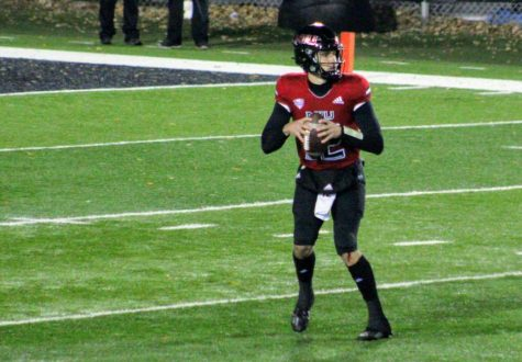 NIU redshirt senior quarterback Ross Bowers looks for an open receiver Nov. 11 during NIU