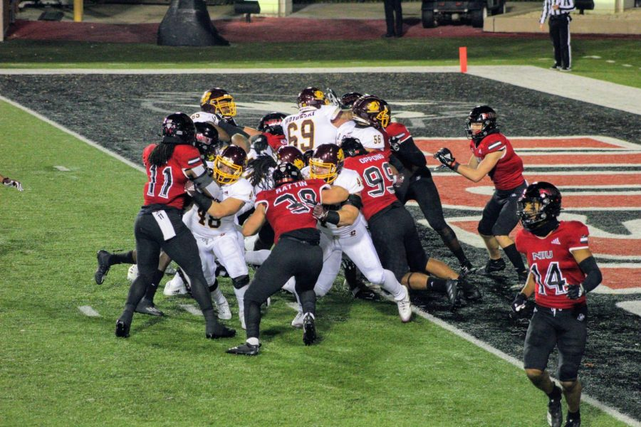 The Huskies defense attempts to stop the Chippewas from scoring Nov. 11, during NIU's 40-10 loss to CMU at Huskie Stadium.