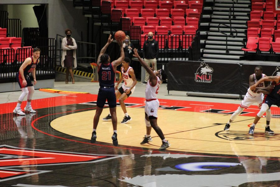 UIC Junior guard RayQuawndis Mitchell (left) hits the game-winning three over NIU sophomore guard Tyler Cochran Nov. 25, during NIU's 65-61 loss to UIC at the NIU Convocation Center in DeKalb, Illinois