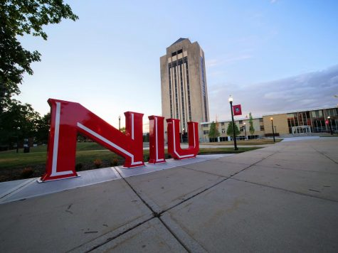 NIU sign in the middle of campus on June 23.