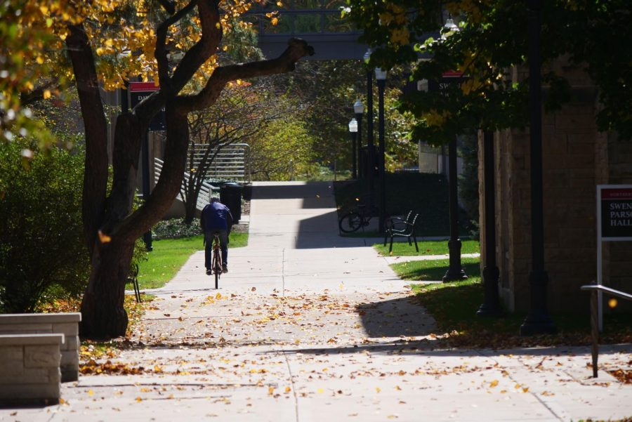 A biker rides past Swen Parson Hall on Oct. 13.
